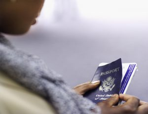 elevated close up view of businesswoman holding passport and ticket