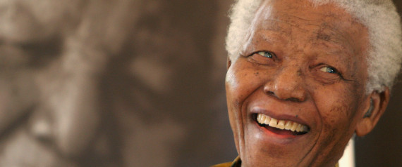"Former South African President, Nelson Mandela, in a jovial mood at the Mandela Foundation in Johannesburg Wednesday, Dec. 7, 2005 where he met with the winner and runner-up of the local "" Idols"" competition. The 87-year-old former political prisoner who became the country's first black president in 1994 remains a popular high profile figure since retiring from public life in recent years. (AP Photo/Denis Farrell)"
