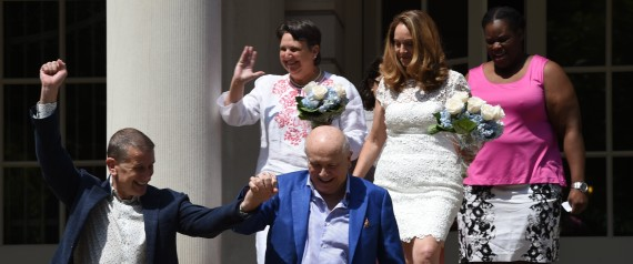 New York City Mayor Bill de Blasio officiate the marriages of (L-R) Terrence McNally and Thomas Kirdahy, Denise Niewinski and Cindy Jackson, and Sarah Joseph and Katrina Council on the steps of City Hall, New York on June 26, 2015. They will make history as the woman are the first couples to exchange their vows with marriage equality as the law of not just our state, but of the entire country. the Supreme Court ruled 5-4 that same-sex marriage be made legal nationwide. AFP PHOTO / TIMOTHY A. CLARY (Photo credit should read TIMOTHY A. CLARY/AFP/Getty Images)