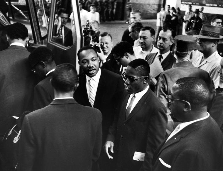 Rev. Martin Luther King Jr. (C, L) with Freedom Riders boarding bus for Jackson, MS..
