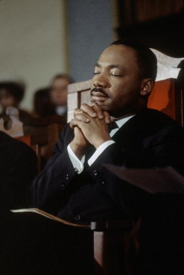 American religious and Civil Rights leader Martin Luther King Jr (1929 - 1968) leads a prayer in a church before the second Selma to Montgomery Civil Rights march, also known as'Turnaround Tuesday', Selma, Alabama, 9th March 1965. (Photo by Frank Dandridge/The LIFE Images Collection/Getty Images)
