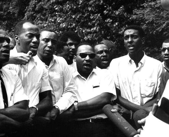Civil rights leaders Floyd B. McKissick (fore, 3L), Dr. Martin Luther King Jr. (4R) and Stokely Carmichael (2R) participating in voter registration march after originator James H. Meredith was shot.