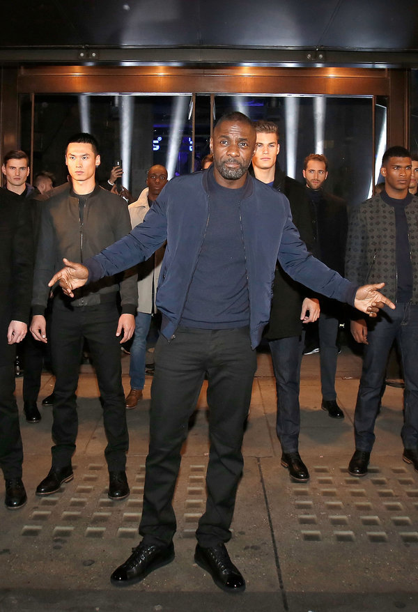 LONDON, ENGLAND - NOVEMBER 26: Idris Elba and models stop traffic as they arrive at Superdry Regent Street to celebrate the launch of the new premium menswear AW15'Idris Elba + Superdry' collection on November 26, 2015 in London, England. (Photo by David M. Benett/Dave Benett / Getty Images for Superdry)