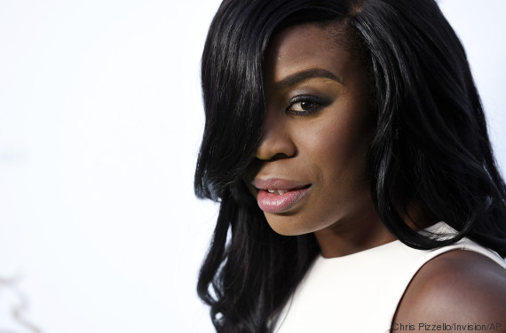 """Actress Uzo Aduba looks back for photographers at the 4th Annual Beyond Hunger: """"A Place at the Table"""" gala at the Montage Hotel on Friday, Sept. 18, 2015, in Beverly Hills, Calif. (Photo by Chris Pizzello/Invision/AP)"""