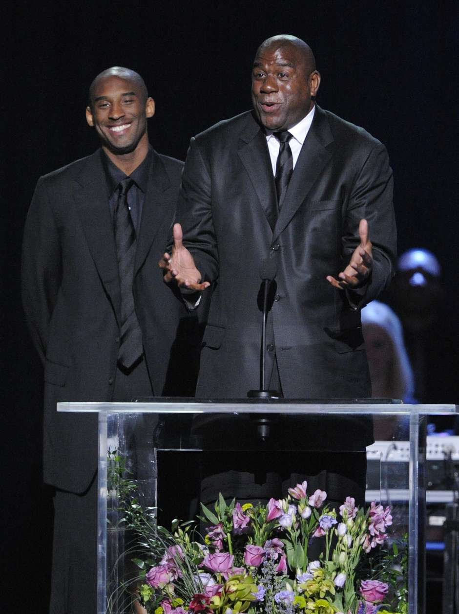 LA Lakers' Kobe Bryant, left, and Magic Johnson speak during the memorial service for Michael Jackson at the Staples Center in Los Angeles, Tuesday, July 7, 2009. (AP Photo/Mark J. Terrill, Pool)