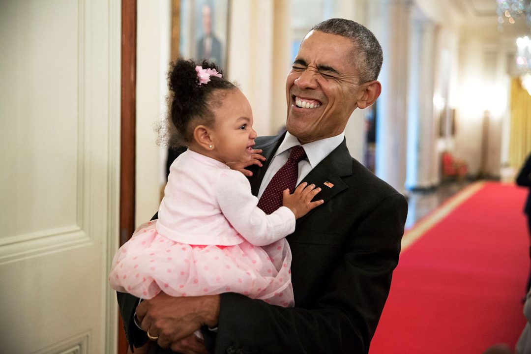 President Barack Obama holds the daughter of former staff member Darienne Page Rakestraw in the Cross Hall of the White House, April 3, 2015. (Official White House Photo by Pete Souza) This official White House photograph is being made available only for publication by news organizations and/or for personal use printing by the subject(s) of the photograph. The photograph may not be manipulated in any way and may not be used in commercial or political materials, advertisements, emails, products, promotions that in any way suggests approval or endorsement of the President, the First Family, or the White House.