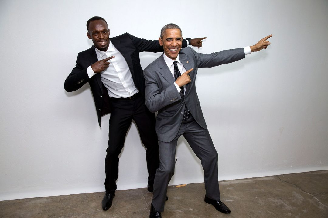 """President Barack Obama poses with Usain Bolt, the fastest runner in the world, backstage following a """"Young Leaders of the Americas Initiative"""" town hall at the University of the West Indies in Kingston, Jamaica, April 9, 2015. (Official White House Photo by Pete Souza) This official White House photograph is being made available only for publication by news organizations and/or for personal use printing by the subject(s) of the photograph. The photograph may not be manipulated in any way and may not be used in commercial or political materials, advertisements, emails, products, promotions that in any way suggests approval or endorsement of the President, the First Family, or the White House."""