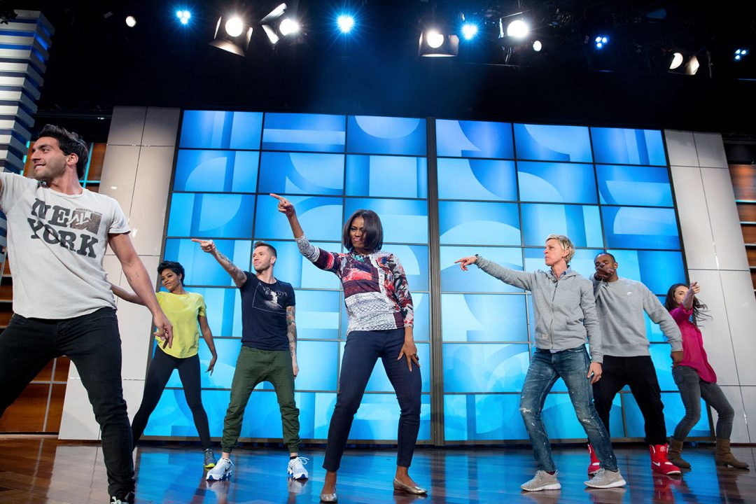 """First Lady Michelle Obama rehearses with Ellen DeGeneres and the """"So You Think You Can Dance"""" dancers for a #GimmeFive """"Let's Move!"""" dance, prior to a taping of The Ellen DeGeneres Show in Burbank, Calif., March 12, 2015. (Official White House Photo by Amanda Lucidon) This official White House photograph is being made available only for publication by news organizations and/or for personal use printing by the subject(s) of the photograph. The photograph may not be manipulated in any way and may not be used in commercial or political materials, advertisements, emails, products, promotions that in any way suggests approval or endorsement of the President, the First Family, or the White House."""