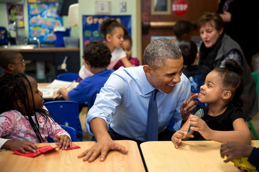 """Jan. 22, 2015 """"While we were in Lawrence, Kan., we stopped at the Community Children's Center–one of the nation's oldest Head Start providers. The President sat next to Akira Cooper, right, and reacted to something she said to him."""" (Official White House Photo by Pete Souza) This official White House photograph is being made available only for publication by news organizations and/or for personal use printing by the subject(s) of the photograph. The photograph may not be manipulated in any way and may not be used in commercial or political materials, advertisements, emails, products, promotions that in any way suggests approval or endorsement of the President, the First Family, or the White House."""