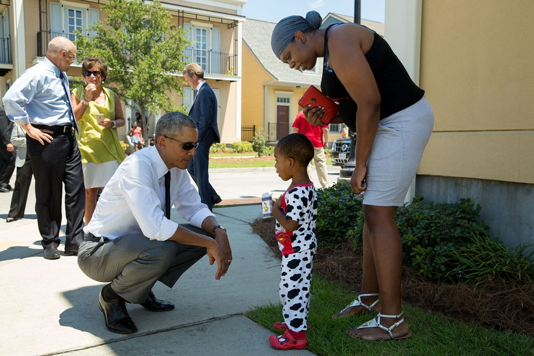 """August 27, 2015 """"Nice pajamas. The President greets residents in the Tremé neighborhood of New Orleans. The area experienced significant flooding during Hurricane Katrina ten years ago, and much of it has been rebuilt."""" (Official White House Photo by Pete Souza) This official White House photograph is being made available only for publication by news organizations and/or for personal use printing by the subject(s) of the photograph. The photograph may not be manipulated in any way and may not be used in commercial or political materials, advertisements, emails, products, promotions that in any way suggests approval or endorsement of the President, the First Family, or the White House."""