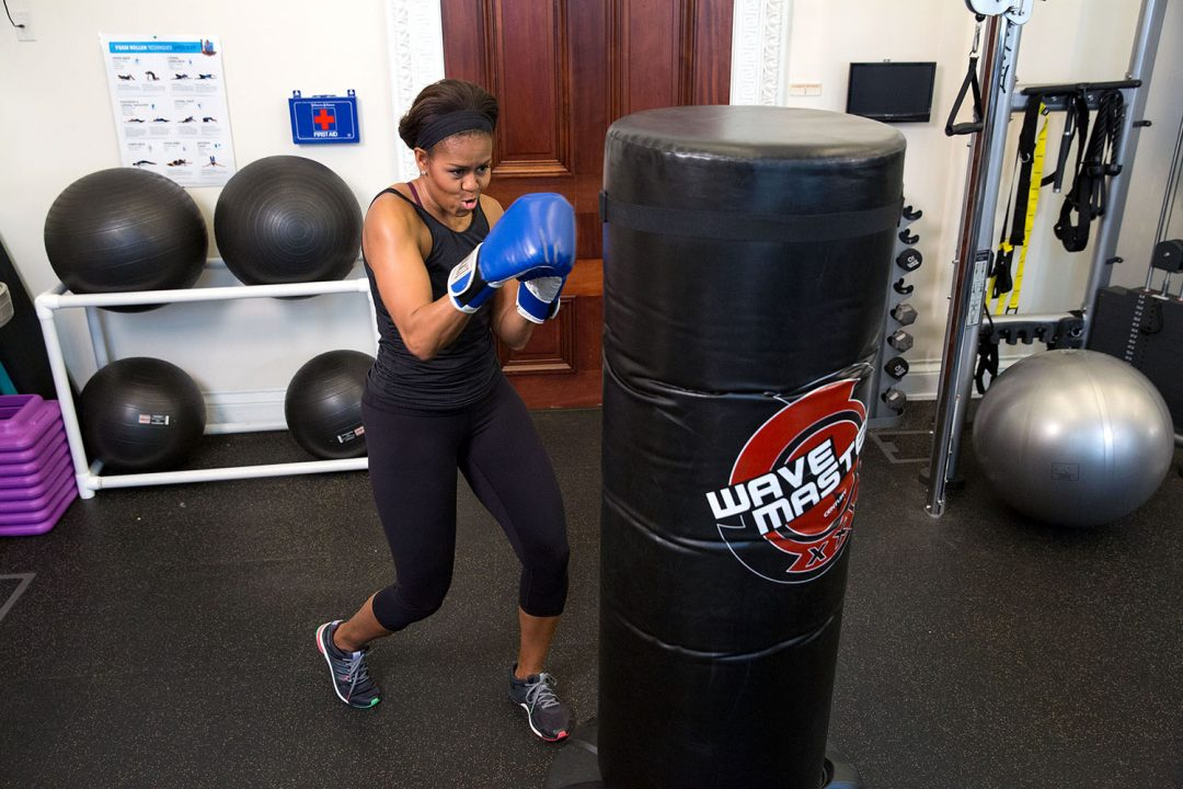 """May 12, 2015 """"The First Lady demonstrates her boxing skills during a #GimmeFive video taping."""" (Official White House Photo by Amanda Lucidon) This official White House photograph is being made available only for publication by news organizations and/or for personal use printing by the subject(s) of the photograph. The photograph may not be manipulated in any way and may not be used in commercial or political materials, advertisements, emails, products, promotions that in any way suggests approval or endorsement of the President, the First Family, or the White House."""