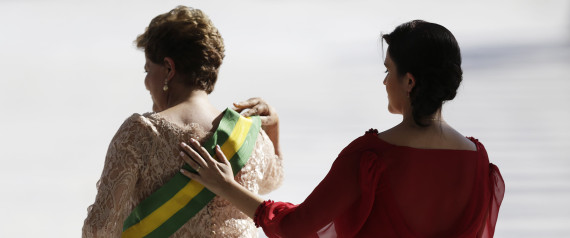 Paula places her hand on the back of her mother, Brazil's President Dilma Rousseff, after Rousseff received the presidential sash after being sworn in for a second four-year term in Brasilia January 1, 2015. Brazil's President Dilma Rousseff began her second term Thursday vowing to rein in government spending to curb inflation and pull Latin America's largest economy out of a four-year slump. REUTERS/Ueslei Marcelino (BRAZIL - Tags: POLITICS)