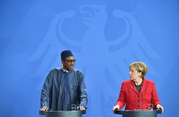 German Chancellor Angela Merkel and Nigeria's President Muhammadu Buhari give a press conference at the Chancellery in Berlin on October 14, 2016. / AFP PHOTO / John MACDOUGALL
