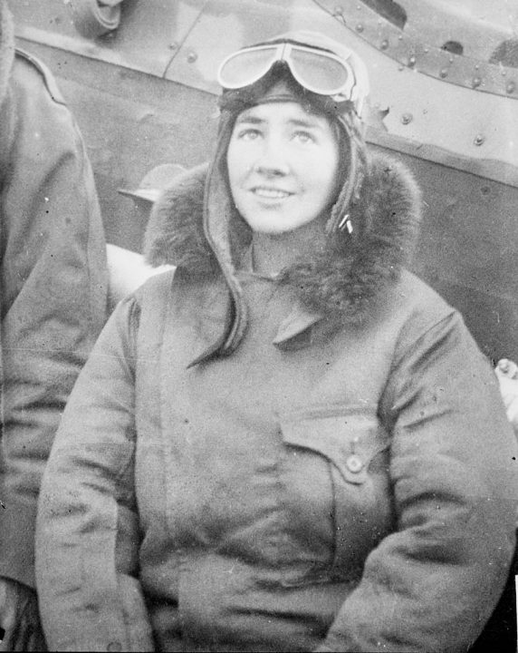 Portrait of Anne Morrow Lindbergh (1906 - 2001), pioneering aviator and wife of Charles Lindbergh, sitting at the side of an airplane on the ground in Chicago, Illinois, 1929. She is wearing a flight jacket with a fur collar, aviator cap and goggles (on top of her head). From the Chicago Daily News collection. (Photo by Chicago History Museum/Getty Images)
