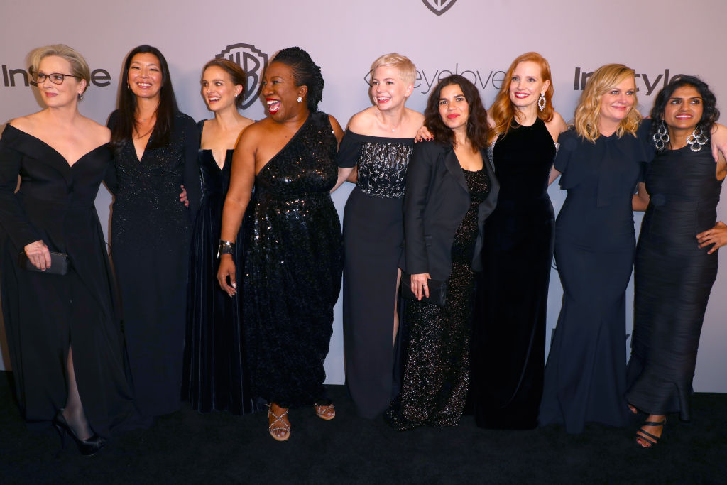 BEVERLY HILLS, CA - JANUARY 07: ( L-R) Actor Meryl Streep, activist Ai-jen Poo, actor Natalie Portman, activist Tarana Burke, actors Michelle Williams, America Ferrera, Jessica Chastain, Amy Poehler and activist Saru Jayaraman attend the 2018 InStyle and Warner Bros. 75th Annual Golden Globe Awards Post-Party at The Beverly Hilton Hotel on January 7, 2018 in Beverly Hills, California. (Photo by Joe Scarnici/Getty Images for InStyle)