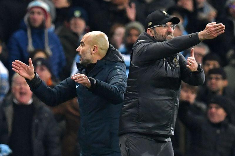 Pep Guardiola e Jurgen Klopp, treinadores de Manchester City e Liverpool, respetivamente Paul ELLIS / AFP