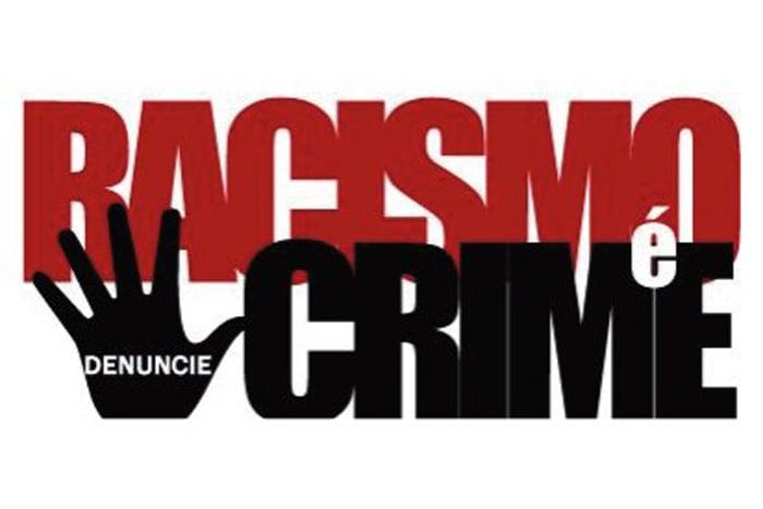 """Ilustração escrito """"Racismo é crime, denuncie"""""""
