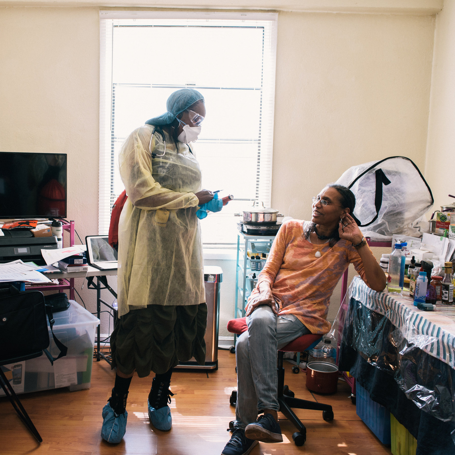 Rochelle Allen, a respiratory therapist, made a home visit to Lisa McClendon, who goes to the emergency room about once a month because of her asthma.Credit...Alexandra Hootnick for The New York Times