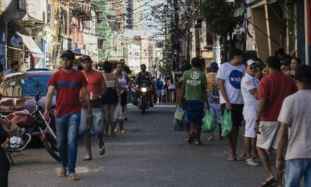 Ruas movimentadas da comunidade de Paraisópolis, em SP Foto: Agência O Globo